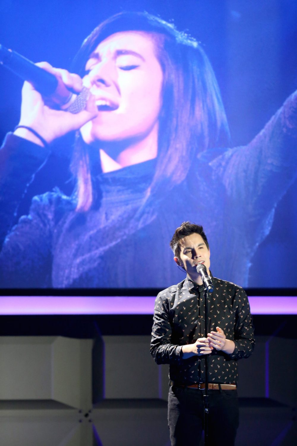 BEVERLY HILLS, CA - OCTOBER 04: Internet personality Sam Tsui (R) performs during a tribute to the late Christina Grimmie (image projected on video screen) during the 6th annual Streamy Awards hosted by King Bach and live streamed on YouTube at The Beverly Hilton Hotel on October 4, 2016 in Beverly Hills, California. (Photo by Frederick M. Brown/Getty Images for dick clark productions )
